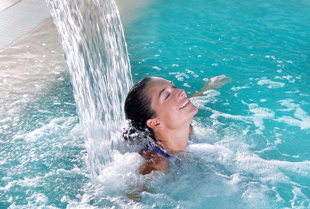 Woman relaxing in a Badenhaus pool