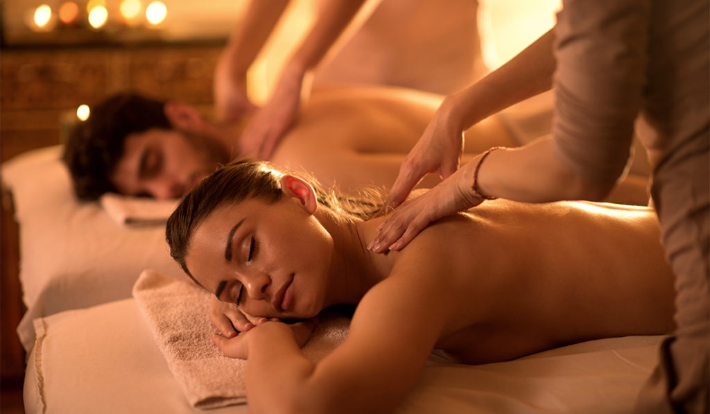 A couple relaxing on a massage table at Badenhaus Spa